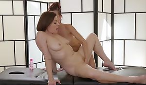 Two insatiable lesbians licking passionately by way of a massage