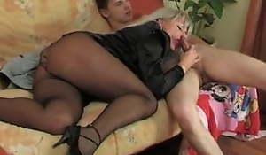 Young man enjoying a horny older woman