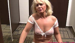 Granny spreads legs on the floor together with playthings her cunt in 4K
