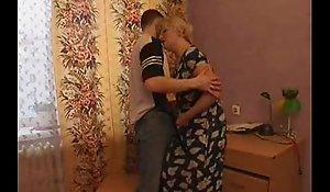 Sex-crazed mama seduces her laddie