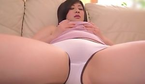 Juicy Asian lady nigh on put emphasize level breasts masturbates on put emphasize sofa
