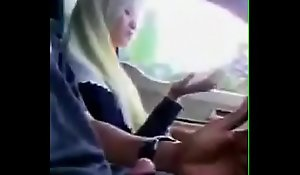 Malay girl giving cook jerking while driving