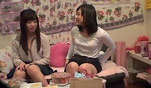 Lovable Asian lady pleasuring her lesbian friend