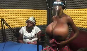 African mum showing her daughter's enormous knockers