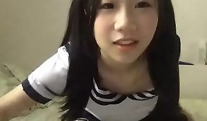 Youthful Chinese Asian student playing in adult free cam site